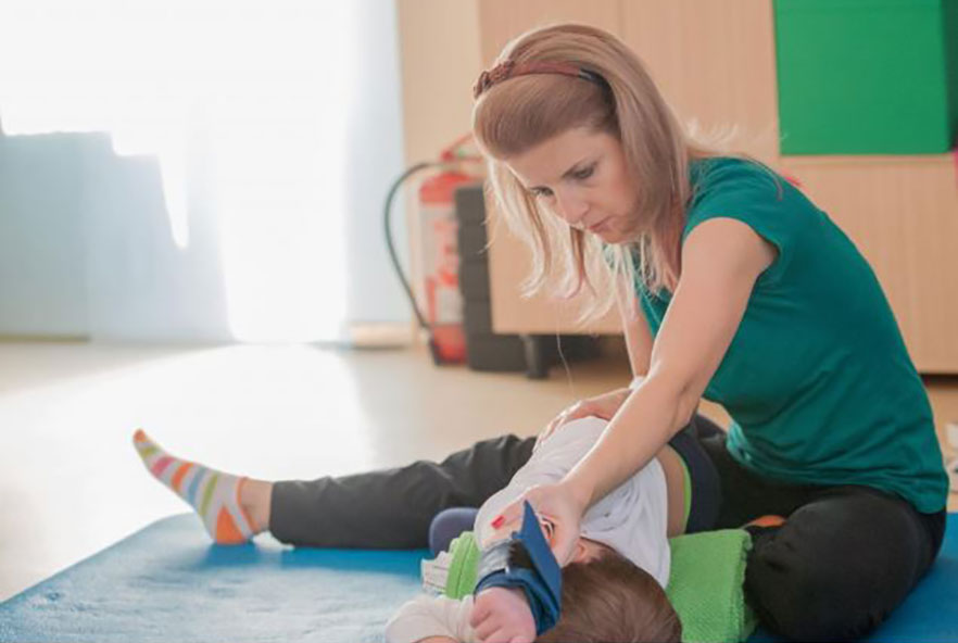 A female physiotherapist treats a child patient