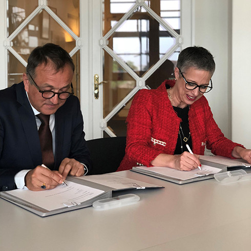 Photograph of Emma Stokes signing MOU with ICRC