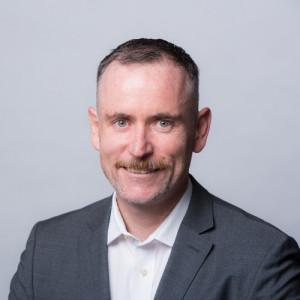 Foto da cabeça de Jonathon Kruger, CEO